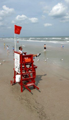 lifeguard sitting on tower on the beach